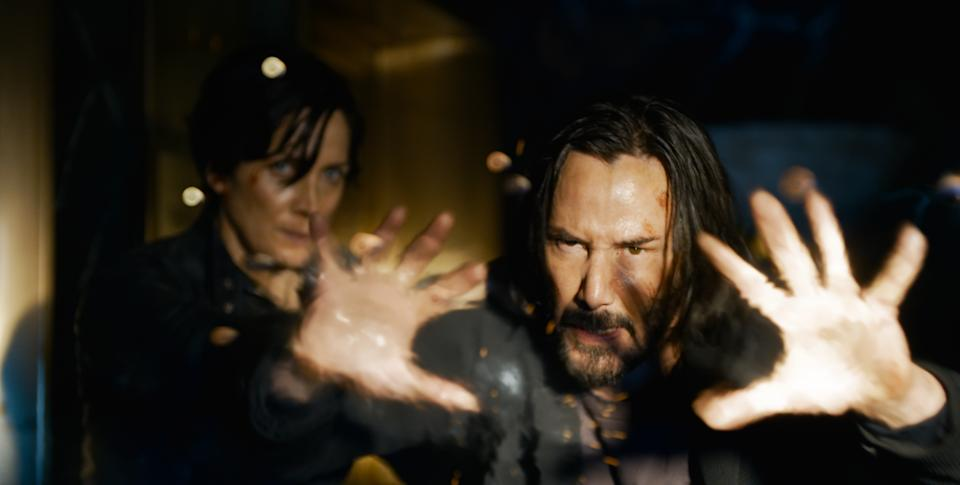 Carrie Anne Moss and Keanu Reeves reprise their roles as Trinity and Neo respectively in The Matrix Resurrections (Photo: Courtesy of Warner Bros.)