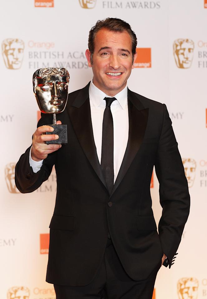 LONDON, ENGLAND - FEBRUARY 12:  Jean Dujardin poses in the press room with the Best Actor award during the Orange British Academy Film Awards 2012 at the Royal Opera House on February 12, 2012 in London, England.  (Photo by Chris Jackson/Getty Images)