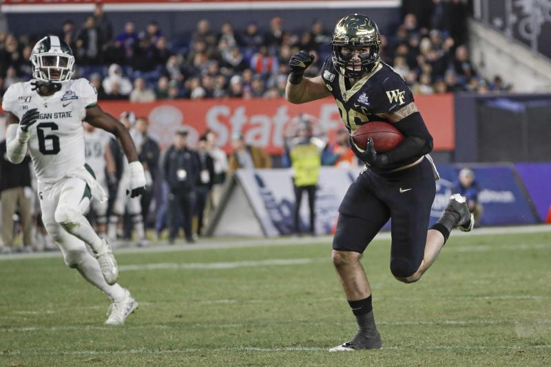 Wake Forest's Jack Freudenthal (86) runs away from Michigan State's David Dowell (6) for a touchdownduring the first half of the Pinstripe Bowl NCAA college football game Friday, Dec. 27, 2019, in New York. (AP Photo/Frank Franklin II)