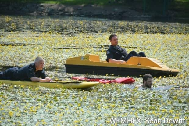 Officers on a paddle board and a pedal boat went into the lake to arrest the man. (Sean DeWitt/Waterfront Media Hfx - image credit)