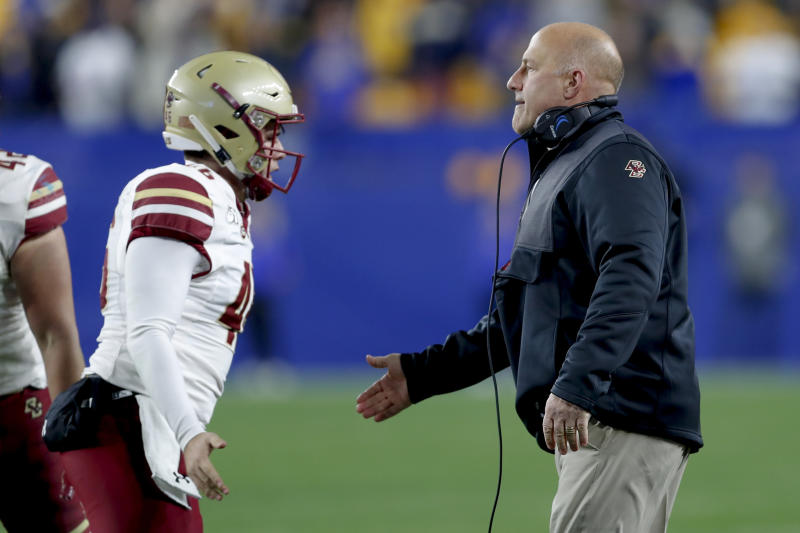 Boston College head coach Steve Addazio, right, greets long snapper Aidan Livingston, left, after the team made a field goal against Pittsburgh during the second half of an NCAA college football game, Saturday, Nov. 30, 2019, in Pittsburgh. (AP Photo/Keith Srakocic)