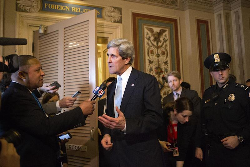 Sen. John Kerry, D-Mass., speaks briefly to reporters as he emerges after a unanimous vote by the Senate Foreign Relations Committee approving him to become America's next top diplomat, replacing Secretary of State Hillary Rodham Clinton, on Capitol Hill in Washington, Tuesday, Jan. 29, 2013. Kerry, who has served on the Foreign Relations panel for 28 years and led the committee for the past four, is expected to be swiftly confirmed by the whole Senate later Tuesday. (AP Photo/J. Scott Applewhite)