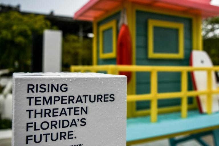 A biodegradable wax sculpture created by Los Angeles artist Bob Partington is showcased for a September 2020 campaign in Miami on climate change, of which many ravaging effects are already felt, including accelerated sea level rise