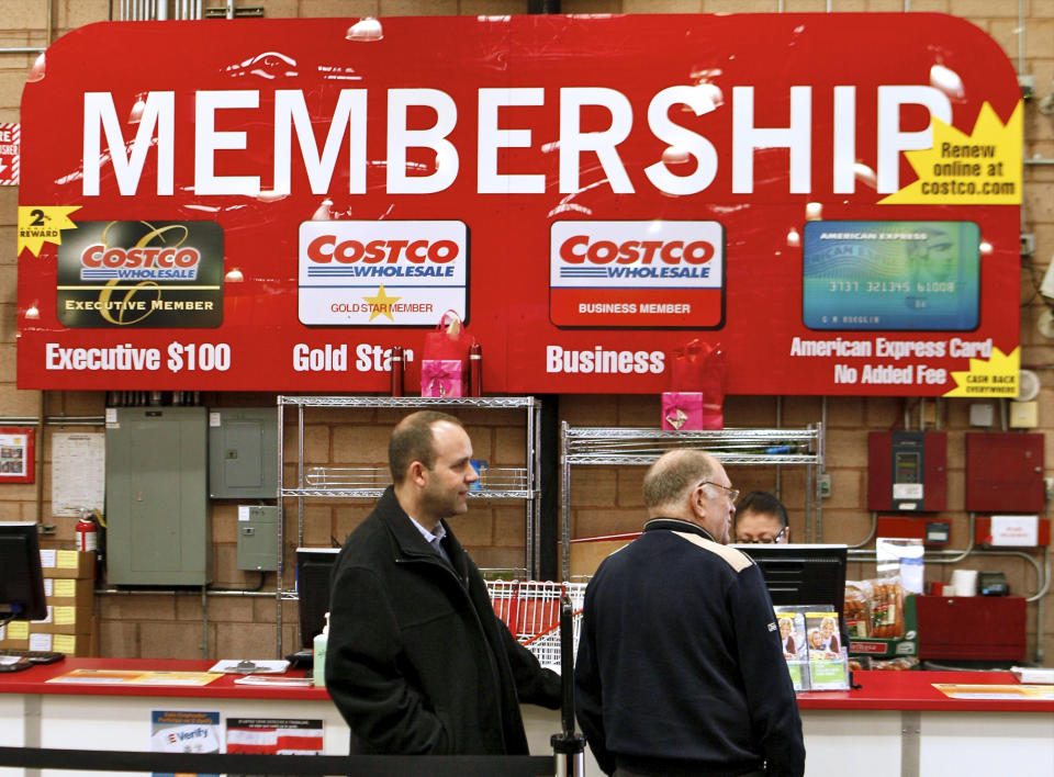 In a photo made on Monday, Feb. 28, 2011, Consumers apply for Costco membership at the Costco Wholesale store in Glendale, Calif.  Costco's fiscal third-quarter net income climbed 19 percent on lower asset charges and the wholesale club pulled in more money from membership fees. (AP Photo/Damian Dovarganes)