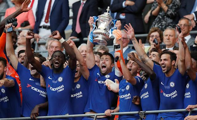 Soccer Football - FA Cup Final - Chelsea vs Manchester United - Wembley Stadium, London, Britain - May 19, 2018 Chelsea's Gary Cahill lifts the trophy as they celebrate winning the final REUTERS/David Klein TPX IMAGES OF THE DAY