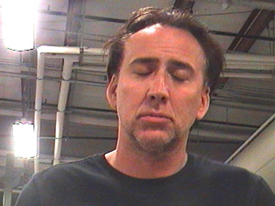 Actor Nicolas Cage is pictured in this booking photograph released on April 16, 2011. Cage has been arrested in New Orleans after a drunken argument with his wife outside a residence in the French Quarter, police said on Saturday. REUTERS/Orleans Parish County Sheriff's Office/Handout (UNITED STATES - Tags: ENTERTAINMENT CRIME LAW HEADSHOT IMAGES OF THE DAY) FOR EDITORIAL USE ONLY. NOT FOR SALE FOR MARKETING OR ADVERTISING CAMPAIGNS. THIS IMAGE HAS BEEN SUPPLIED BY A THIRD PARTY. IT IS DISTRIBUTED, EXACTLY AS RECEIVED BY REUTERS, AS A SERVICE TO CLIENTS
