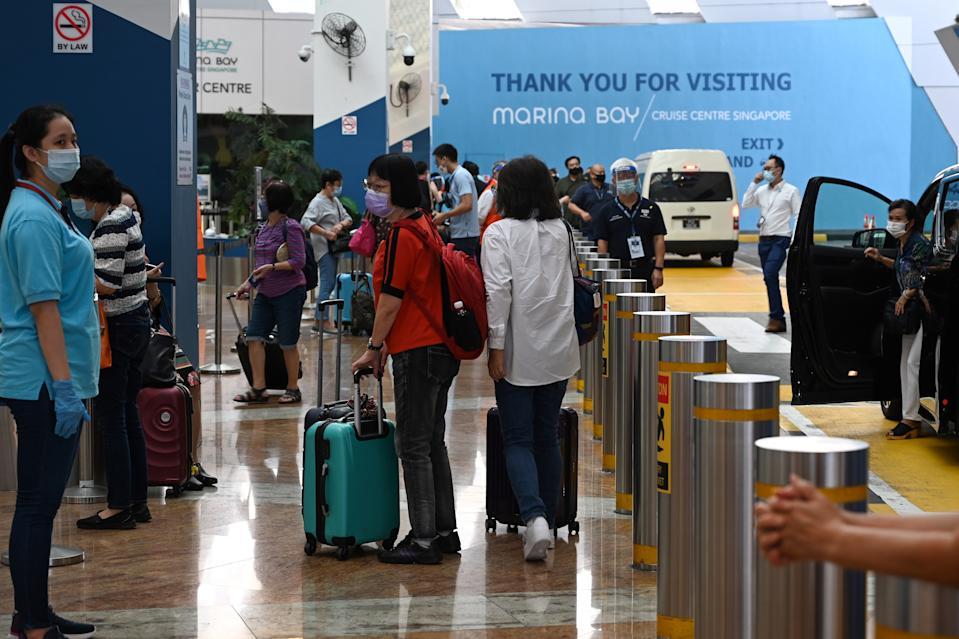 Passengers arrive at the departure area at Marina Bay Cruise Centre in Singapore.