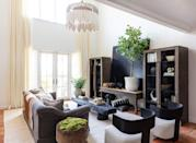 """<p>Surrounded by saturated hues in the house, <a href=""""https://www.mikelwelch.com/"""" rel=""""nofollow noopener"""" target=""""_blank"""" data-ylk=""""slk:Welch"""" class=""""link rapid-noclick-resp"""">Welch</a> wanted to create a """"palette cleanser"""" when it came to this family room area. And this ultrasleek space does exactly that. With its warm whitewashed walls (Swiss Coffee by <a href=""""https://www.benjaminmoore.com/en-us/color-overview/find-your-color/color/oc-45/swiss-coffee?color=OC-45"""" rel=""""nofollow noopener"""" target=""""_blank"""" data-ylk=""""slk:Benjamin Moore"""" class=""""link rapid-noclick-resp"""">Benjamin Moore</a>) and burl-wood-bowl olive tree from <a href=""""http://www.briggstree.com/"""" rel=""""nofollow noopener"""" target=""""_blank"""" data-ylk=""""slk:Briggs & Co."""" class=""""link rapid-noclick-resp"""">Briggs & Co.</a>, this room is a tranquil breath of fresh air in the house.</p>"""