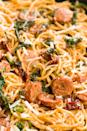 """<p>This meaty spaghetti in a cream sauce is the whole package for an easy dinner.</p><p>Get the recipe from <a href=""""https://www.delish.com/cooking/recipe-ideas/recipes/a45764/spaghetti-with-sun-dried-tomatoes-sausage-and-spinach-recipe/"""" rel=""""nofollow noopener"""" target=""""_blank"""" data-ylk=""""slk:Delish"""" class=""""link rapid-noclick-resp"""">Delish</a>.<br></p>"""