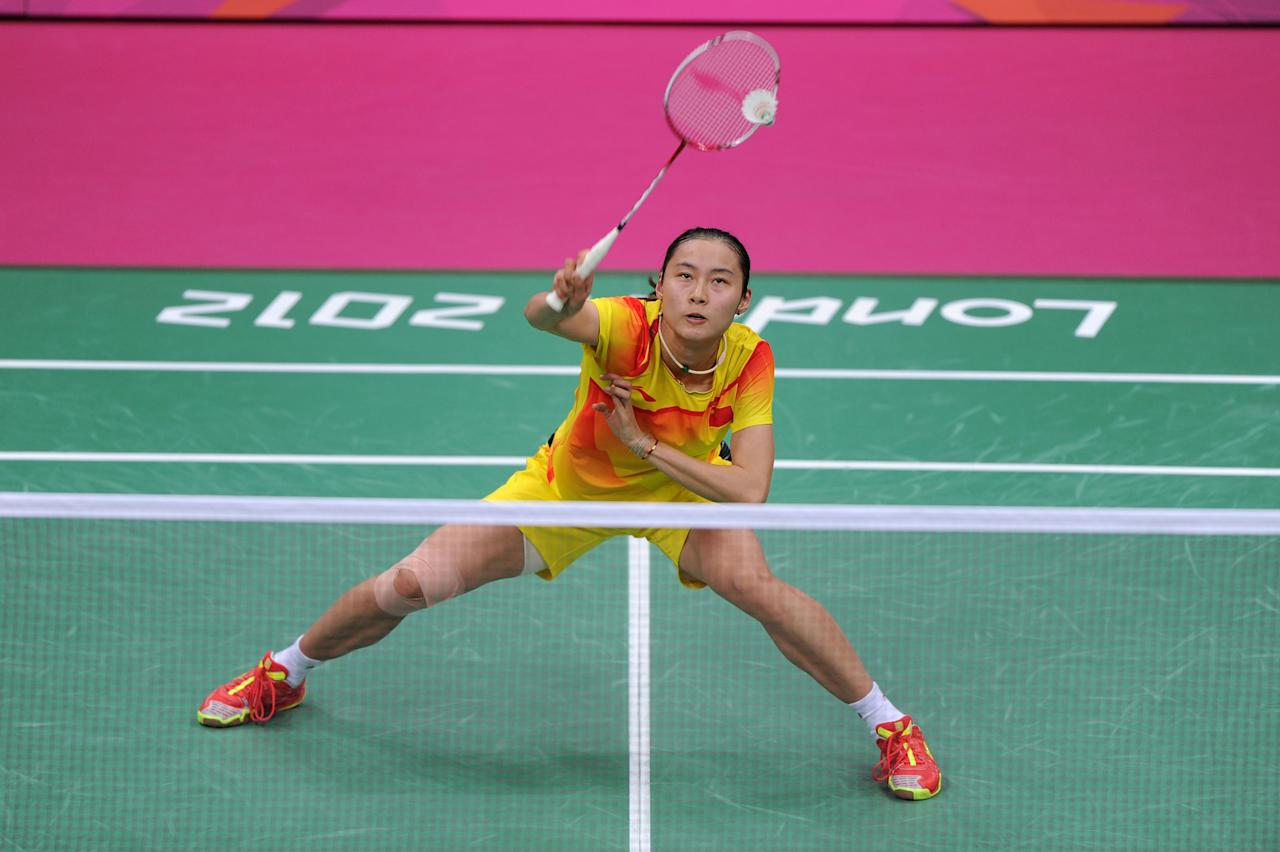 LONDON, ENGLAND - AUGUST 03:  Yihan Wang of China in action in the Women's Singles Badminton Semi-Final against Saina Nehwal of India on Day 7 of the London 2012 Olympic Games at Wembley Arena on August 3, 2012 in London, England.  (Photo by Michael Regan/Getty Images)