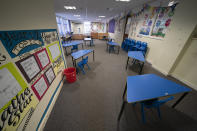 A classroom with safely spaced desks laid out before the possible reopening of Lostock Hall Primary school in Poynton near Manchester, England, Wednesday May 20, 2020. Since March 20, the coronavirus has forced British schools to close to all but a small number of key workers' children and those under social care. The government wants children to start returning to primary schools in stages from June 1. Those going back first include the youngest — ages 4 to 6. (AP Photo/Jon Super)
