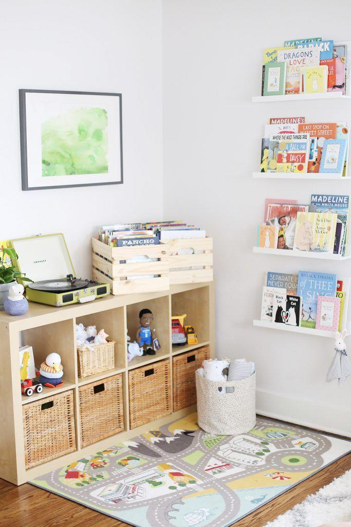 """<p>Create the ultimate play corner with wall storage for books, a vintage record player, bins for toys, and a playful rug.</p><p><strong>See more at <a href=""""https://projectnursery.com/projects/baby-viklunds-cool-calm-eclectic-nursery/"""" rel=""""nofollow noopener"""" target=""""_blank"""" data-ylk=""""slk:Project Nursery"""" class=""""link rapid-noclick-resp"""">Project Nursery</a>.</strong></p><p><strong><strong><a class=""""link rapid-noclick-resp"""" href=""""https://www.amazon.com/Wallniture-Mounted-Floating-Shelves-Nursery/dp/B071X9TQQ7?tag=syn-yahoo-20&ascsubtag=%5Bartid%7C10063.g.36014277%5Bsrc%7Cyahoo-us"""" rel=""""nofollow noopener"""" target=""""_blank"""" data-ylk=""""slk:SHOP KIDS' BOOKSHELVES"""">SHOP KIDS' BOOKSHELVES</a></strong><br></strong></p>"""