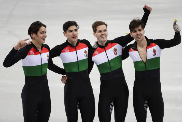Hungary's 5000 meters speedskating relay team celebrates its historic gold medal. (AP Photo/Julie Jacobson)