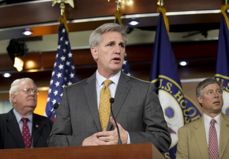 House Majority Whip Kevin McCarthy of Calif., center, accompanied by Rep. Joe Pitts, R-Pa., left, Rep. Fred Upton, R-Mich., gestures during a news conference on Capitol Hill in Washington, Thursday, March 22, 2012, after the House voted along party lines to repeal a Medicare cost-control board that's part of President Barack Obama's health care overhaul law. (AP Photo/J. Scott Applewhite)