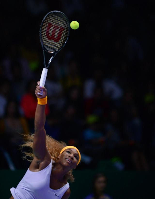 Serena Williams of the USA returns a shot to Jelena Jankovic of Serbia during their semifinal tennis match at the WTA Championship in Istanbul, Turkey, Saturday, Oct. 26, 2013. The world's top female tennis players compete in the championships which runs from Oct. 22 until Oct. 27.(AP Photo)