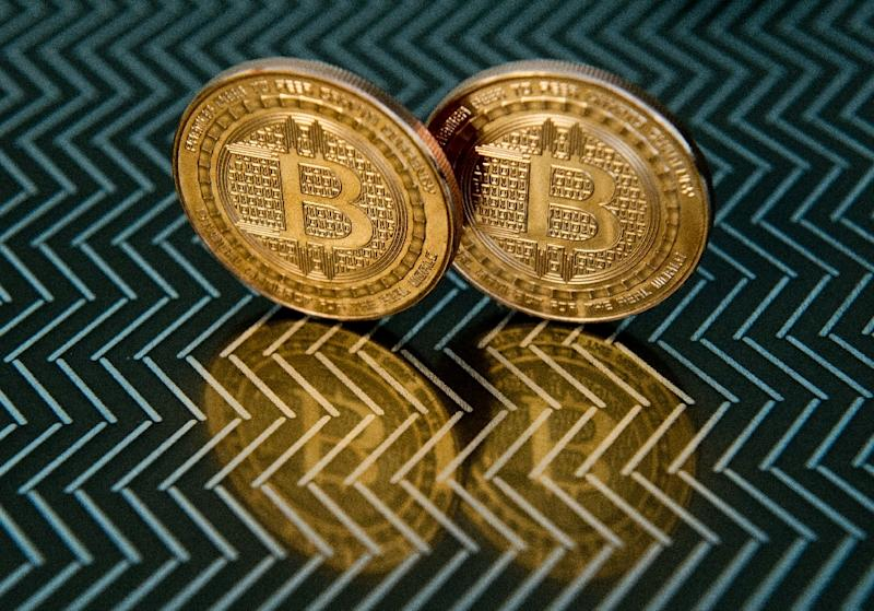 """A key US regulator gave the green light for trading in bitcoin futures on two major exchanges, but warned """"of the potentially high level of volatility and risk in trading these contracts"""" (AFP Photo/KAREN BLEIER)"""
