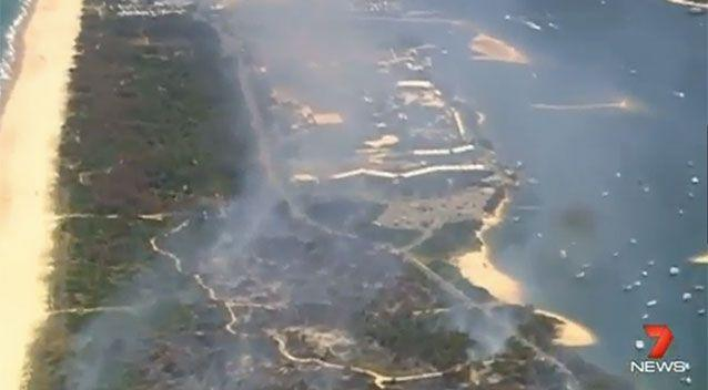 Scenes from the fire on the Gold Coast where the snakes were living. Source: 7 News.