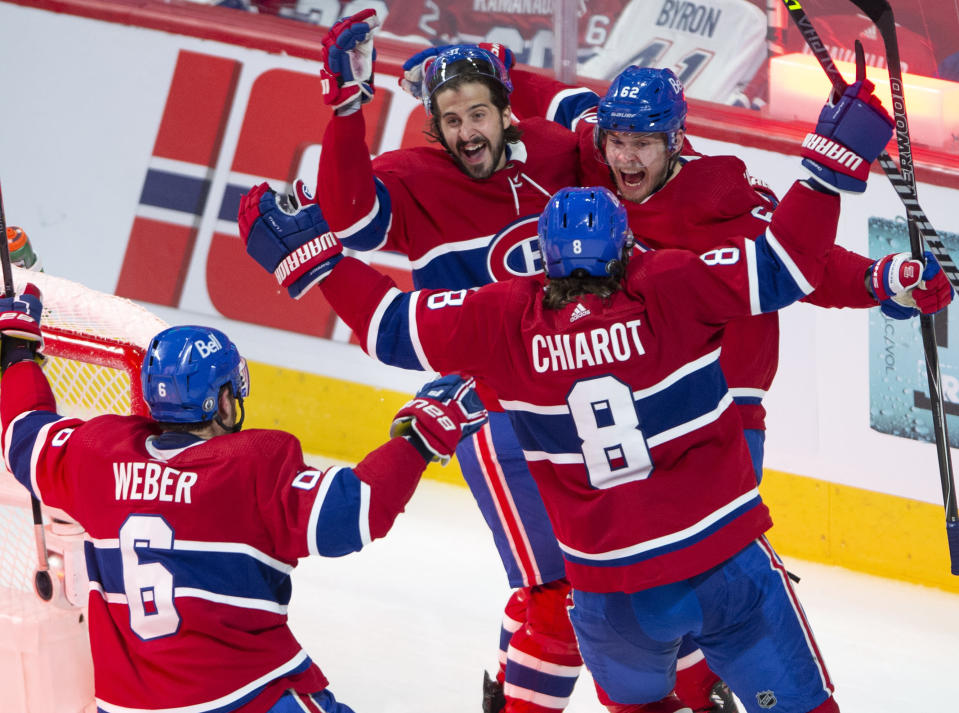 Montreal Canadiens left wing Artturi Lehkonen (62) celebrates with teammates after scoring the winning goal against the Vegas Golden Knights during overtime in Game 6 of an NHL hockey Stanley Cup semifinal playoff series Thursday, June 24, 2021 in Montreal. (Ryan Remiorz/The Canadian Press via AP)
