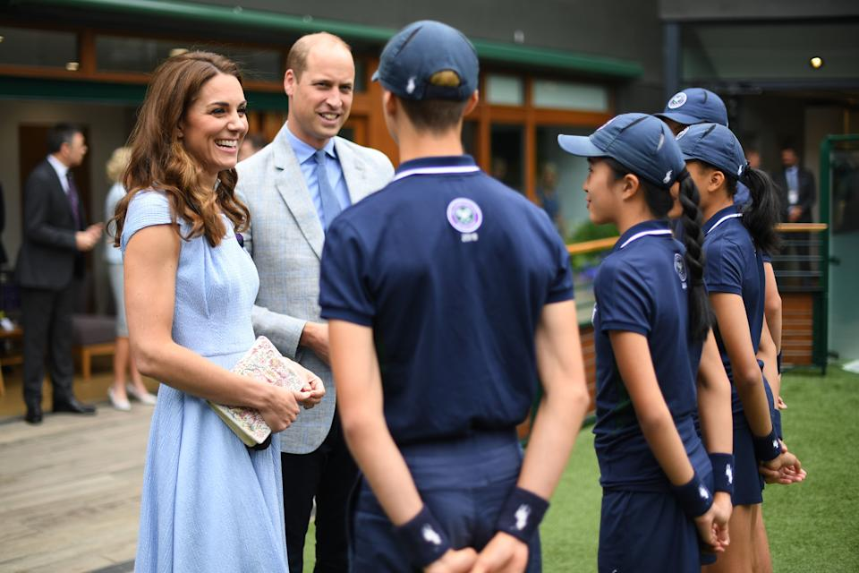 LONDON, UNITED KINGDOM - JULY 14: Catherine, Duchess of Cambridge and Prince William, Duke of Cambridge meet ballboys and ballgirls  (right to left) Tom Hubner, 15, Rhianne Black, 14, Kayleigh Man, 13 and Cassius Hayman, 15, ahead of the Men's Singles Final on day thirteen of the Wimbledon Championships at the All England Lawn Tennis and Croquet Club, Wimbledon on July 14, 2019, in London, England. (Photo by Victoria Jones - WPA Pool/Getty Images)