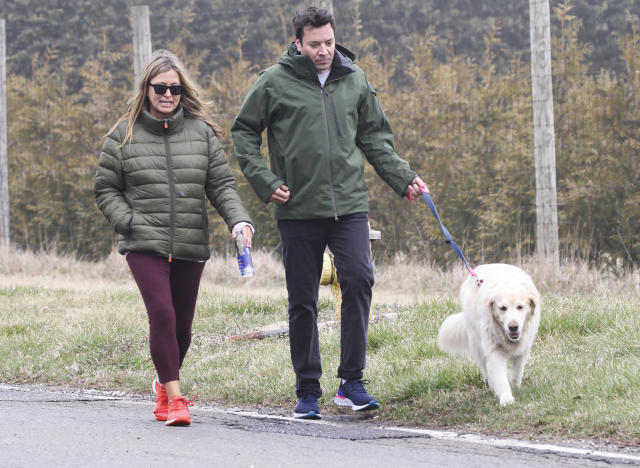 <p>Jimmy Fallon and wife Nancy Juvonen take their dog for a walk on Friday in The Hamptons, New York.</p>