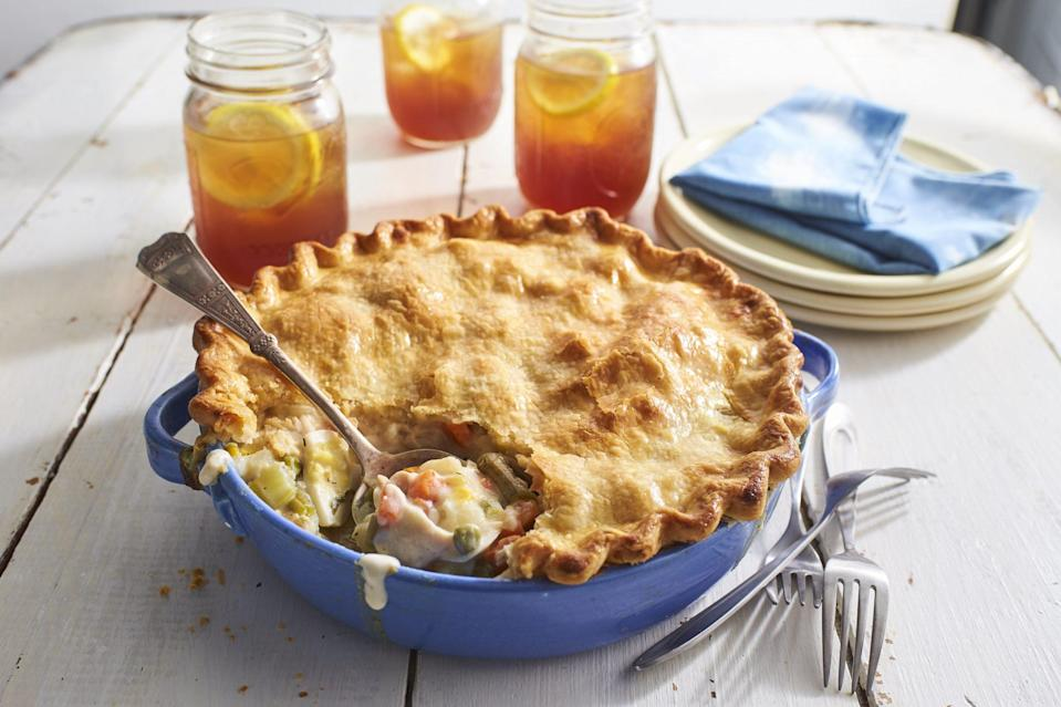 """<p><strong>Recipe: <a href=""""https://www.southernliving.com/recipes/old-fashioned-chicken-pot-pie-recipe"""" rel=""""nofollow noopener"""" target=""""_blank"""" data-ylk=""""slk:Old-Fashioned Chicken Pot Pie"""" class=""""link rapid-noclick-resp"""">Old-Fashioned Chicken Pot Pie</a></strong></p> <p>When it comes to chicken pot pie, from scratch is always best, but frozen vegetables and refrigerated pie crust make the recipe attainable. </p>"""