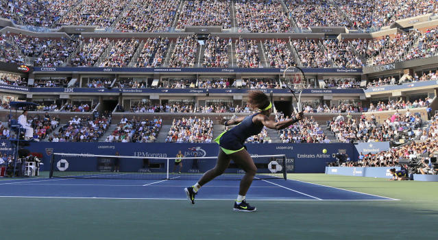 Serena Williams returns a shot to Victoria Azarenka, of Belarus, during the championship match at the 2012 US Open tennis tournament, Sunday, Sept. 9, 2012, in New York. (AP Photo/Charles Krupa)