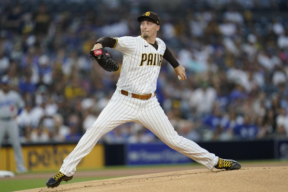 San Diego Padres starting pitcher Blake Snell works against a Los Angeles Dodgers batter during the first inning of a baseball game Wednesday, Aug. 25, 2021, in San Diego. (AP Photo/Gregory Bull)