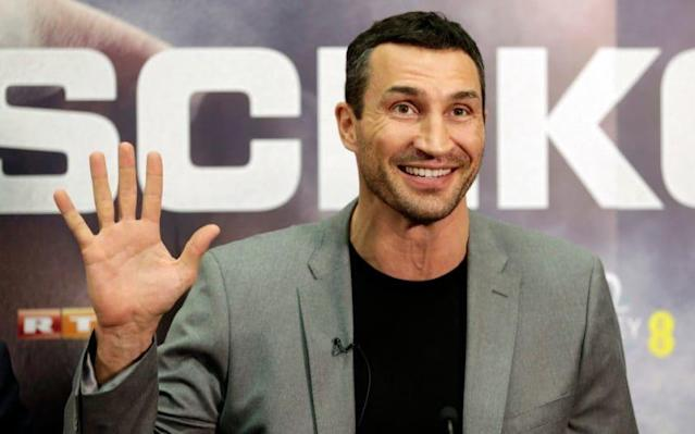 <span>Wladimir Klitschko waves at the Wembley press conference</span> <span>Credit: Action Images </span>