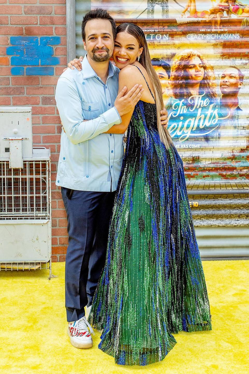 <p>Lin-Manuel Miranda gets a big hug from Leslie Grace at the <em>In the Heights</em> 2021 Tribeca Festival opening night premiere at the United Palace Theater on June 9 in N.Y.C.</p>
