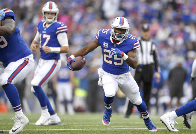 FILE- In this Oct. 7, 2018, file photo, Buffalo Bills running back LeSean McCoy (25) carries with the ball during the first half of an NFL football game against the Tennessee Titans in Orchard Park, N.Y. Two struggling AFC East rivals with uncertain quarterback situations square off when the Bills and New York Jets meet on Sunday. (AP Photo/Adrian Kraus, File)
