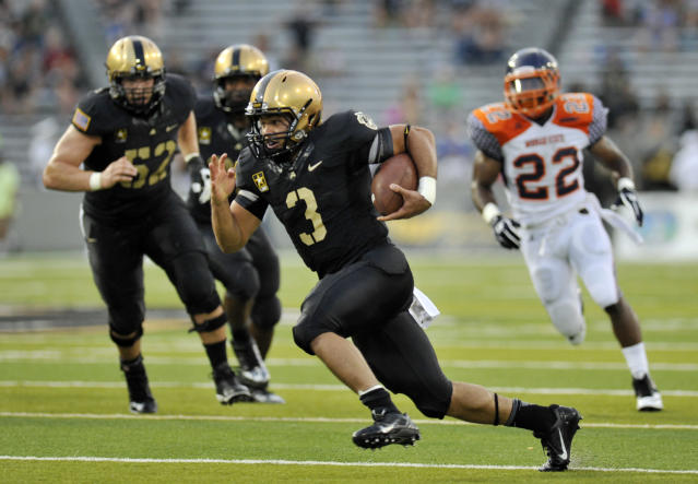 Army quarterback Angel Santiago (3) runs for a touchdown against Morgan State during the first half of an NCAA college football game on Friday, Aug. 30, 2013, in West Point, N.Y. (AP Photo/Hans Pennink)