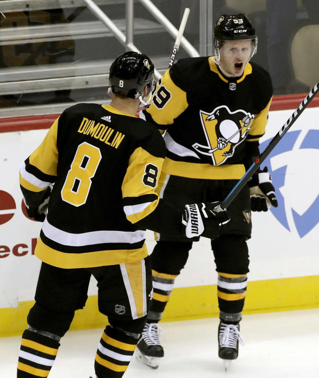 Pittsburgh Penguins' Jake Guentzel celebrates his goal with Brian Dumoulin during the first period in Game 4 of an NHL first-round hockey playoff series against the New York Islanders in Pittsburgh, Tuesday, April 16, 2019. (AP Photo/Gene J. Puskar)