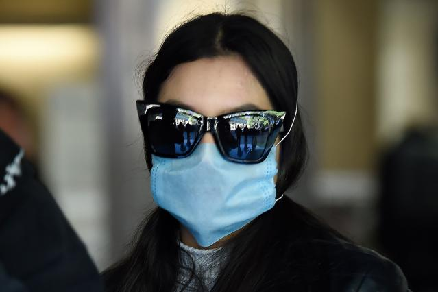 A passenger is pictured wearing a mask at Mexico City's international airport on 28 February. (Getty Images)