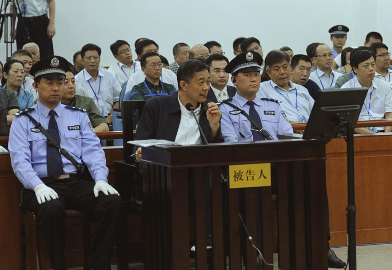 In this photo released by the Jinan Intermediate People's Court, former Politburo member and party leader of the megacity of Chongqing Bo Xilai, in the defendant seat listens to a testimony by former Chongqing city police chief Wang Lijun, unseen, at Jinan Intermediate People's Court in Jinan in eastern China's Shandong province, Saturday, Aug. 24, 2013. Disgraced Chinese politician Bo told a court Saturday his wife stole government funds without his involvement and revealed how the couple became estranged after he had been unfaithful, offering a glimpse in his politically charged trial of the unraveling of one of China's elite families. Wang triggered Bo's downfall when he fled to a US consulate with revelations that Bo's wife had killed a British businessman. (AP Photo/Jinan Intermediate People's Court)