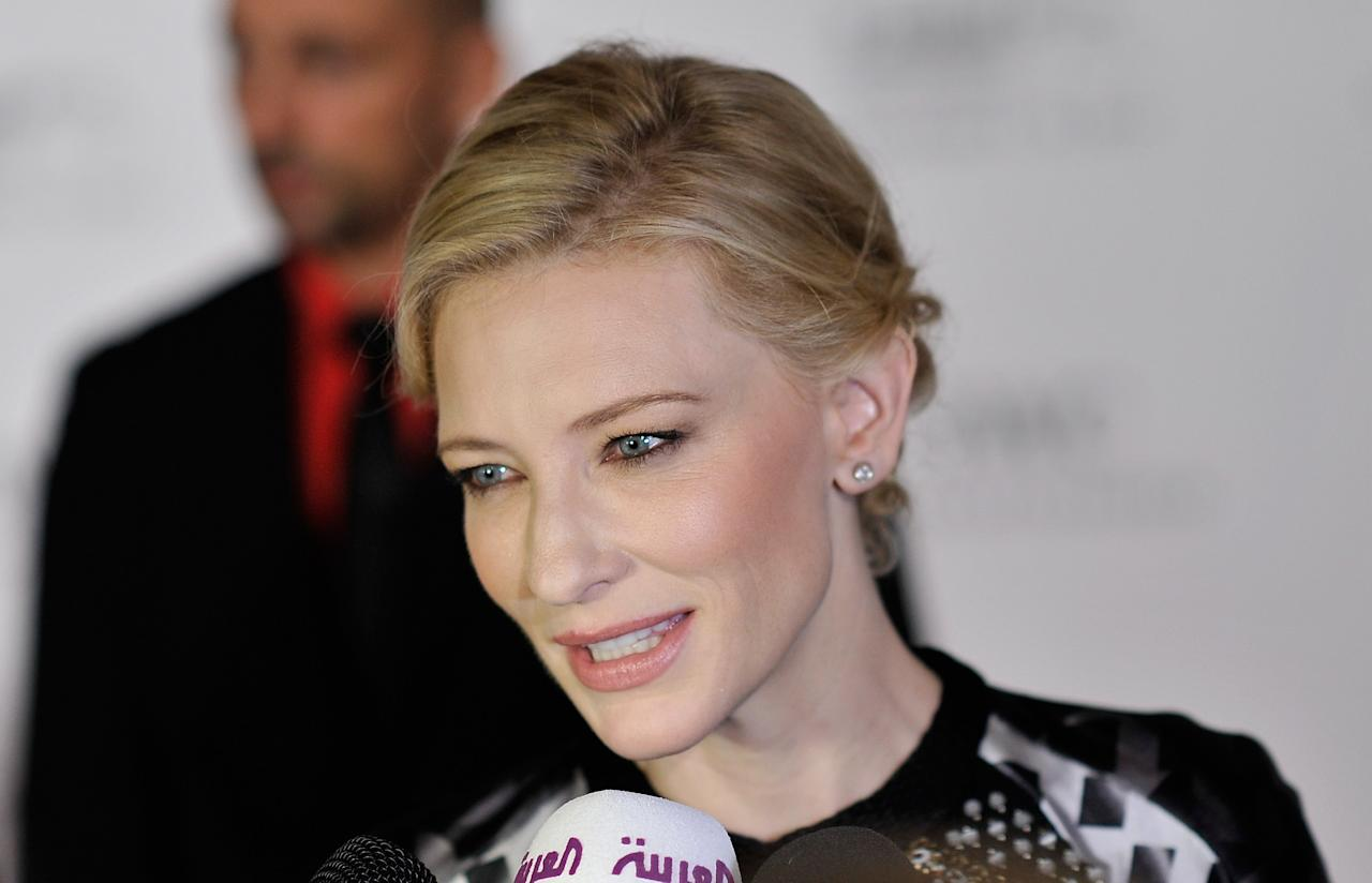 DUBAI, UNITED ARAB EMIRATES - DECEMBER 10:  Actress Cate Blanchett speaks to the media as she attends the Dubai International Film Festival and IWC Schaffhausen Filmmaker Award Gala Dinner and Ceremony at the One and Only Mirage Hotel on December 10, 2012 in Dubai, United Arab Emirates.  (Photo by Gareth Cattermole/Getty Images for DIFF)