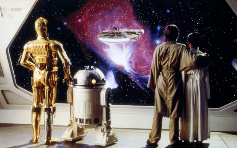 Anthony Daniels, Kenny Baker, Mark Hamill and Carrie Fisher on the set of The Empire Strikes Back