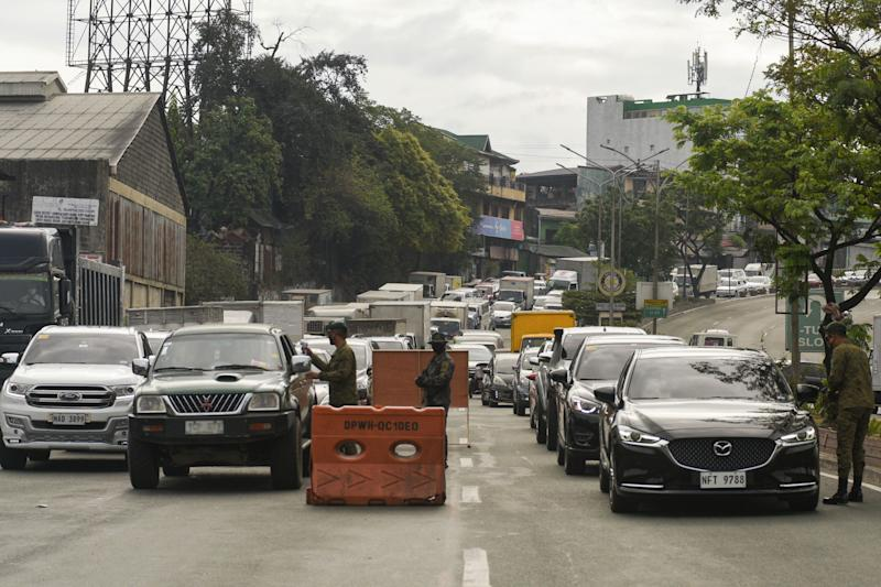 FILE PHOTO: Vehicles pile up at the boundary of Manila and the North Luzon Expressway Mindanao Avenue exit during rush hour in Manila on March 16, 2020, with temperature and identification checkpoints as part of measures to reduce the spread of the COVID-19 pandemic. (Photo: MARIA TAN/AFP via Getty Images)