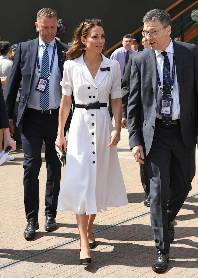 "<p>Catherine, Duchess of Cambridge attended day two of Wimbledon wearing a <a href=""https://www.townandcountrymag.com/society/tradition/a28258730/kate-middleton-white-dress-wimbledon-2019/"" target=""_blank"">white shirtdress with black detailing.</a></p>"