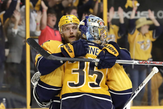 Nashville Predators defenseman Mattias Ekholm, left, of Sweden, hugs goalie Pekka Rinne (35), of Finland, in the final seconds of Game 4 of the team's first-round NHL hockey playoff series against the Chicago Blackhawks Thursday, April 20, 2017, in Nashville, Tenn. The Predators won 4-1 to sweep the series. (AP Photo/Mark Humphrey)