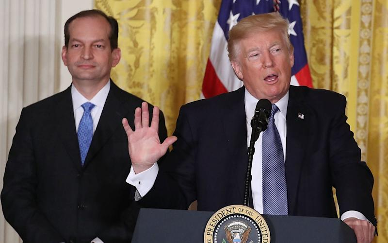 Alex Acosta, the labour secretary, pictured with Donald Trump. Mr Acosta insists he did not bungle the 2007 investigation into Jeffrey Epstein - Getty Images North America