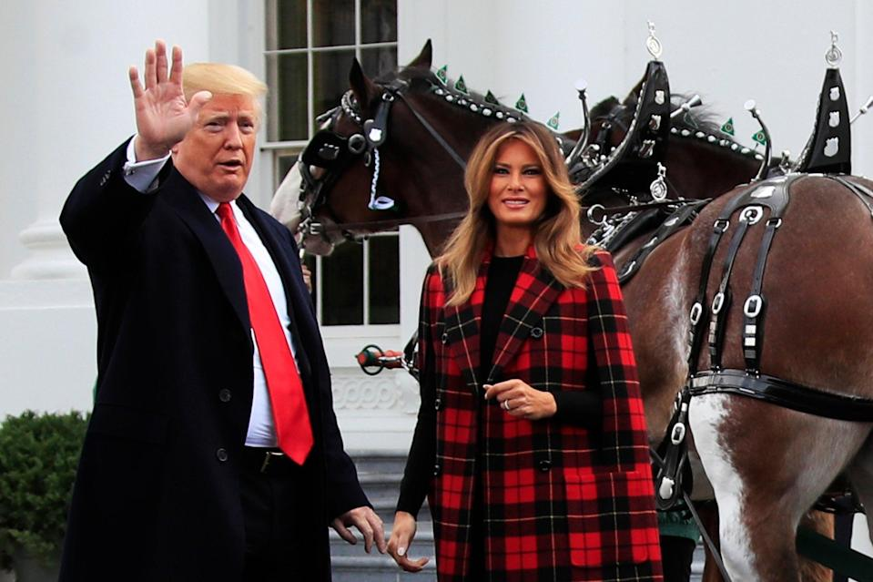 President Donald Trump and first lady Melania Trump wave during a ceremony to receive the White House Christmas Tree (AP)