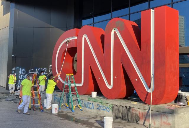 CNN's logo getting cleaned. (Yahoo)