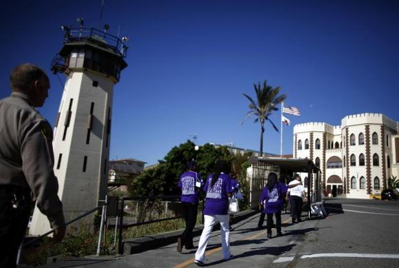 Families are led by a guard into San Quentin state prison in San Quentin, California June 8, 2012.