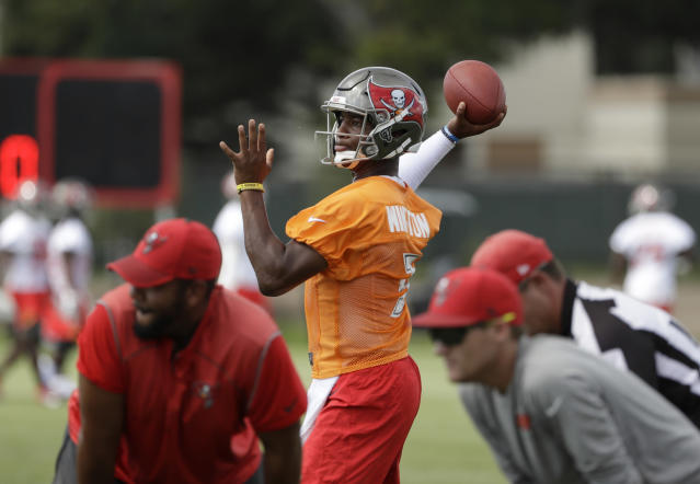 FILE - In this June 14, 2018, file photo, Tampa Bay Buccaneers quarterback Jameis Winston (3) passes during an NFL football minicamp in Tampa, Fla. Winston was notified Thursday, June 28, 2018, by the NFL Special Counsel for Conduct, that he has been suspended without pay for the Buccaneers' first three regular-season games for a violation of the NFL's Personal Conduct Policy.(AP Photo/Chris O'Meara)
