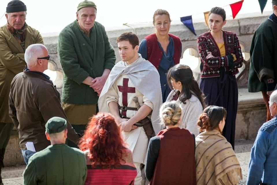 "Actor Taron Egerton as ""Robin Hood"" (C-L) and actress Eve Hewson as ""Maid Marian"" (C-R) play during the film shooting of ""Robin Hood: Origins"" in Dubrovnik, Croatia, on February 20, 2017 (AFP Photo)"