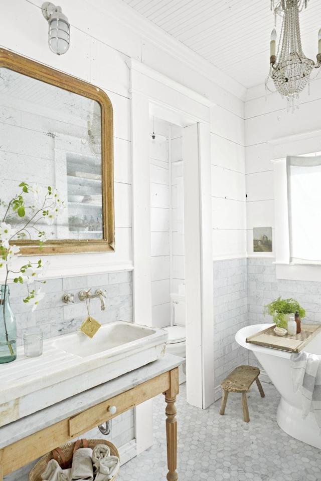 "<p>These homeowners created a one-of-a-kind vanity with a vintage French table and a beautiful marble countertop and sink. Marble countertops can scratch and stain, but if you like character, you may find that the ""flaws"" only add a little patina.<br></p>"