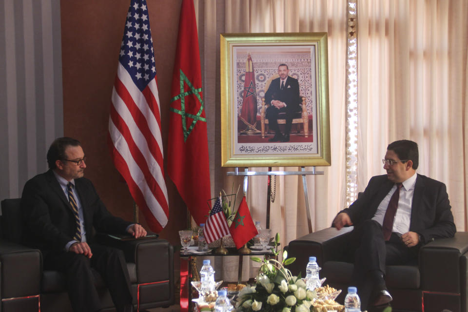 David Schenker, US Assistant Secretary of State for Near Eastern Affairs, left, meets with Nasser Bourita, Moroccan Foreign Minister Nasser Bourita, in Dakhla, Morocco-administered Western Sahara, Jan. 10, 2021. The highest ranking U.S. diplomat for North Africa and the Middle East, as well as the first ever U.S Ambassador, traveled Sunday to the Morocco-administered Western Sahara city of Dakhla, laying the groundwork for the United States to set up a consulate in the disputed territory. (AP Photo/Noureddine Abakchou)