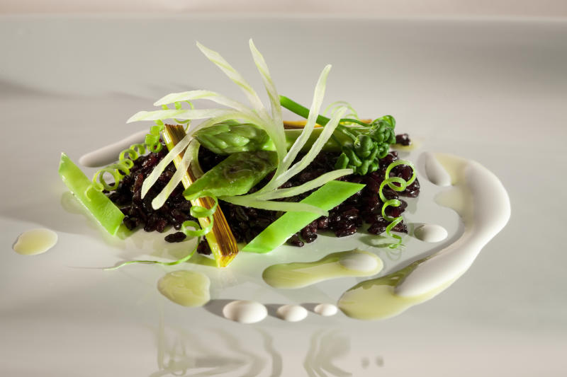 This 2009 photo released by Lotus PR shows lightly toasted black rice with green vegetables and Brazil nut milk in Brazil. Brazil's number one chef is a man on a mission. Alex Atala, whose Sao Paulo-based D.O.M. is among the top-ranked restaurants in the world, is out to transform the reputation of Brazilian cuisine, not only abroad but also at home. (AP Photo/Cassio Vasconcellos, Lotus PR)