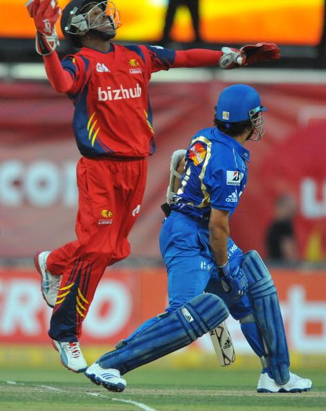 JOHANNESBURG, SOUTH AFRICA - OCTOBER 14:  Thami Tsolekile of the Lions celebrates the wicket of Sachin Tendulkar of Mumbai during the Karbonn Smart CLT20 match between bizhub Highveld Lions and Mumbai Indians at Bidvest Wanderers Stadium on October 14, 2012 in Johannesburg, South Africa. (Photo by Duif du Toit / Gallo Images/Getty Images)