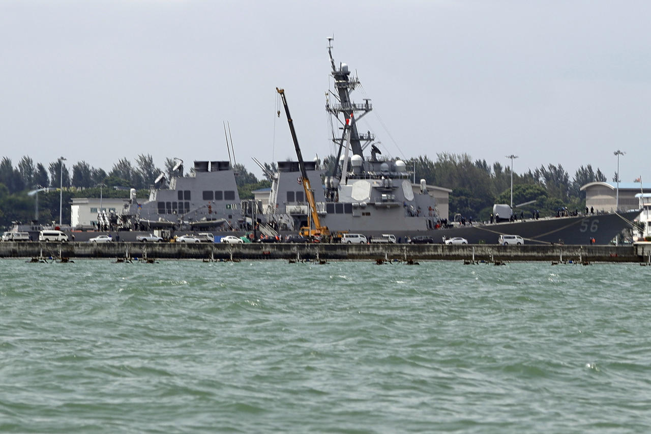 "The USS John S. McCain is seen docked at Changi naval base after its accident Monday, Aug. 21, 2017 in Singapore. The USS John S. McCain was docked at Singapore's naval base with ""significant damage"" to its hull after an early morning collision with the oil tanker Alnic MC as vessels from several nations searched Monday for missing U.S. sailors. (AP Photo/Wong Maye-E)"
